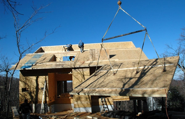 Lifting a roof panel into place on a project for Macfarlane Homes, Va, 2006